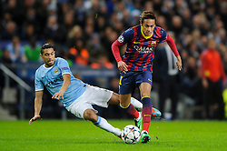 Barcelona Forward Neymar (BRA) is tackled by Man City Defender Gael Clichy (FRA) - Photo mandatory by-line: Rogan Thomson/JMP - Tel: 07966 386802 - 18/02/2014 - SPORT - FOOTBALL - Etihad Stadium, Manchester - Manchester City v Barcelona - UEFA Champions League, Round of 16, First leg.