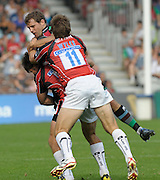 Twickenham, GREAT BRITAIN,  Harlequins' Nick EVANS. lifted in the tackle, during the Guinness Premiership match. Harlequins vs Saracens at the Twickenham Stoop Stadium, Surrey on Sat. 19.09.2009.  [Photo. Peter Spurrier/Intersport-images]