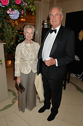 DAME ANTOINETTE SIBLEY and PANTON CORBETT at a dinner hosted by the Royal Academy of Dance to present the Queen Elizabeth II Award 2014 held at Claridge's, Brook Street, London on 4th September 2014.