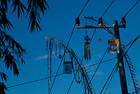 Traditional festival decorations hang on power lines - Bali revisited February 2017
