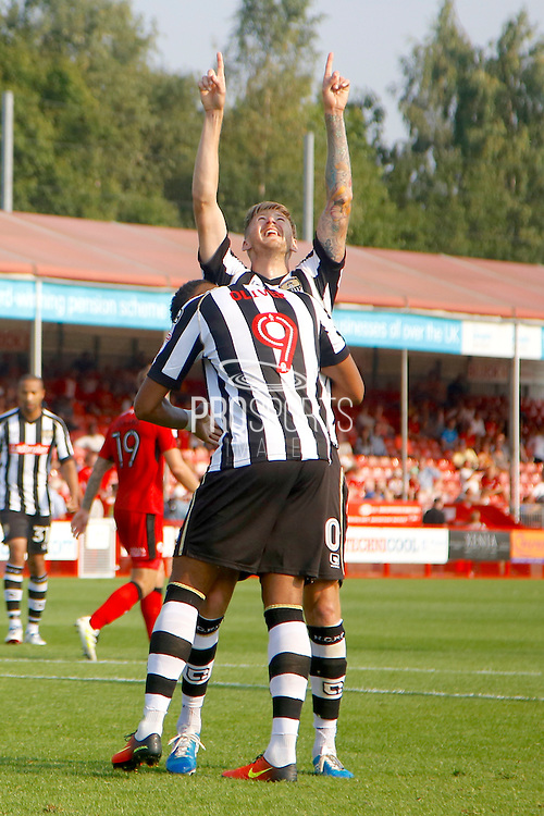 Notts County forward Jonathan Stead (30) and Notts County forward Vadaine Oliver (9) celebrates Steadd's goal during the EFL Sky Bet League 2 match between Crawley Town and Notts County at the Checkatrade.com Stadium, Crawley, England on 27 August 2016. Photo by Andy Walter.