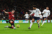 Chris Mepham (33) of AFC Bournemouth clears the ball to deny Mohamed Salah (11) of Liverpool a shot at goal during the Premier League match between Bournemouth and Liverpool at the Vitality Stadium, Bournemouth, England on 7 December 2019.