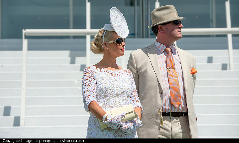 TODAY PICTURE © Licensed to London News Pictures. 06/06/2014. Epsom, UK. Jillian Kelliher from Cork, Ireland, wears a white outfit. Ladies Day today 6th June 2014 at Epsom 2014 Investic Derby Festival in Surrey. Traditionally, elegant, fashionable racegoers gather for a classic day's racing at Epsom Racecourse, Surrey. Photo credit : Stephen Simpson/LNP