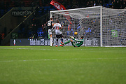 Brentford defender James Tarkowski  blasts the ball into the net after Bolton Wanderers midfielder Neil Danns scores  during the Sky Bet Championship match between Bolton Wanderers and Brentford at the Macron Stadium, Bolton, England on 30 November 2015. Photo by Simon Davies.