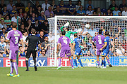 Greg Wylde of Plymouth Argyle scores and celebrates during the Sky Bet League 2 match between AFC Wimbledon and Plymouth Argyle at the Cherry Red Records Stadium, Kingston, England on 8 August 2015. Photo by Stuart Butcher.