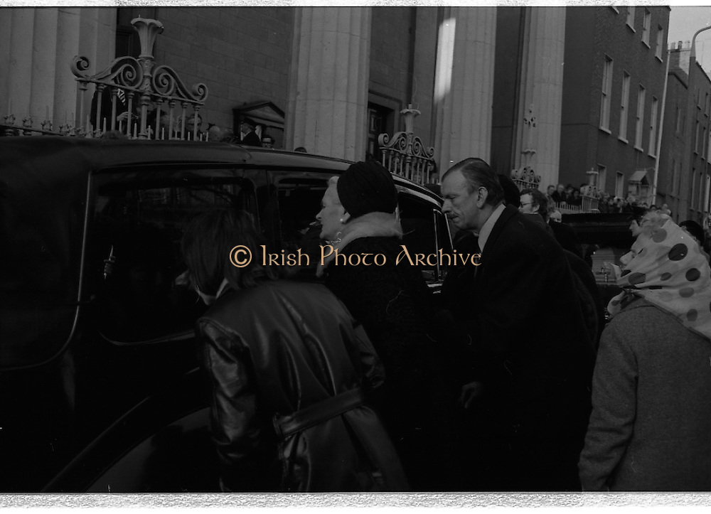 Funeral of Sinead Bean DeValera.    (H82)..1975..09.01.1975..01.09.1975..9th January 1975..Today saw the funeral of Sinead Bean DeValera take place at the Pro Cathedral, Dublin. She was the wife of Ex-President Eamon DeValera. Mrs Devalera was a noted author of childrens literature..Mrs DeValera, Born 3rd June 1878. Died 7th Jan 1975...Image of mourners as they pay their last respects.