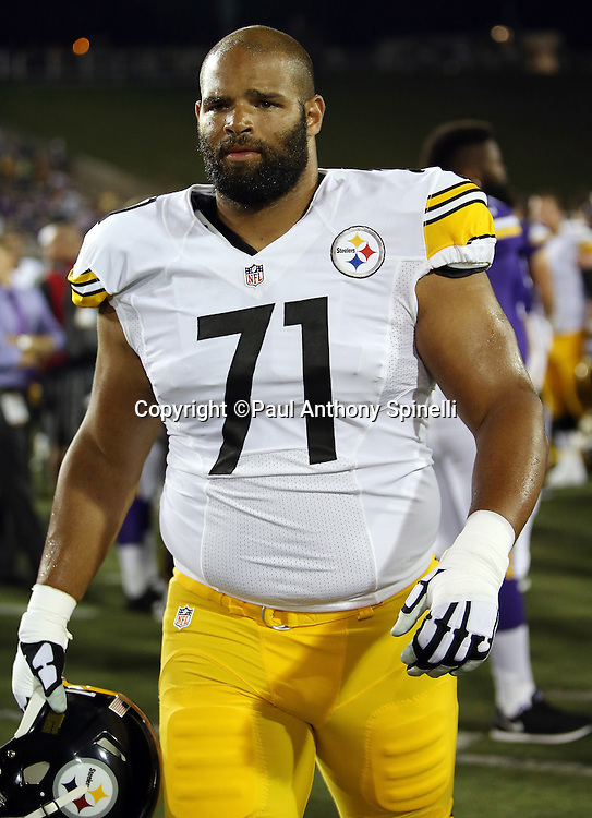 Pittsburgh Steelers tackle Kevin Whimpey (71) walks off the field after the 2015 NFL Pro Football Hall of Fame preseason football game against the Minnesota Vikings on Sunday, Aug. 9, 2015 in Canton, Ohio. The Vikings won the game 14-3. (©Paul Anthony Spinelli)