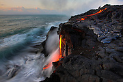 A finger of pahoehoe pushes its way to the ocean's edge and begins dripping over a 30 foot cliff at Kupapa'u, forever altering the Kalapana seacoast.