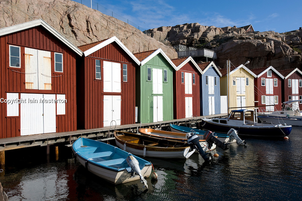 Colored traditional wooden boathouses in harbour at Smogen village on Sweden's Bohuslan coast