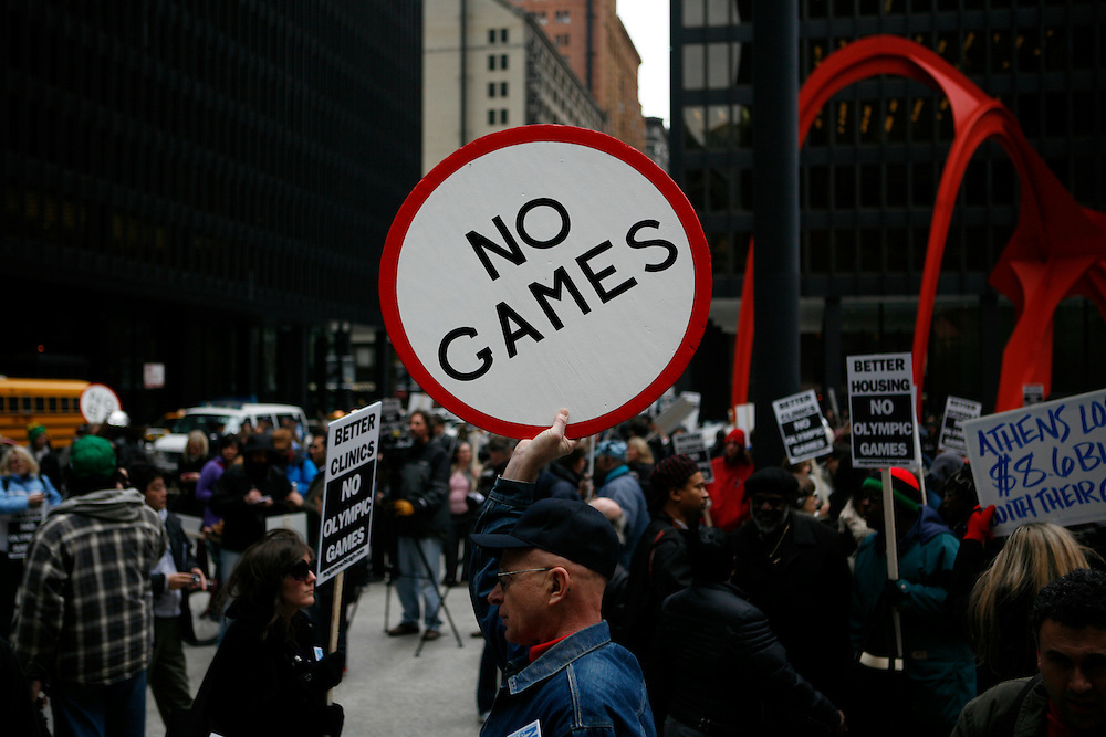 The United States' third largest city, Chicago, has become one of the world's final four candidates to host the 2016 summer olympics. On 2 April 2009, when the International Olympics Committee paid a visit to Chicago, a newly formed group called No Games Chicago, staged a demonstration in the city's downtown. The group is demanding that Chicago Mayor Richard Daley better the situation for Chicago's residents before inviting the costly olympics to the city. ///A protestor holds a sign against the 2016 olympics in Chicago at Federal Plaza in downtown Chicago.