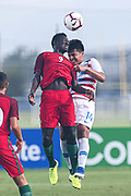Team USA defender Angel Martinez (14) and Portugal forward Herculano Nabian (9) go up for a header during a CONCACAF boys under-15 championship soccer game, Saturday, August 10, 2019, in Bradenton, Fla. Portugal defeated Team USA 3-0 and advanced to the finals against Slovenia. (Kim Hukari/Image of Sport)