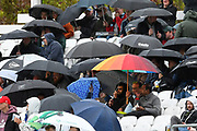 Spectators huddle under their umbrellas up as they wait for the start of the match which has been delayed by rain during the Royal London ODI match between England and Pakistan at the Kia Oval, Kennington, United Kingdom on 8 May 2019.