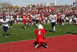 29 October 2005: Left all alone, Redbird Pierre Jackson kneels in the endzone to accept a pass from Luke Drone. With a final score of 31 - 17, Western Illinois University Leathernecks collared the Illinois State University Redbirds knocking them from their 18th ranked perch at Hancock Field on Illinois State's campus in Normal IL