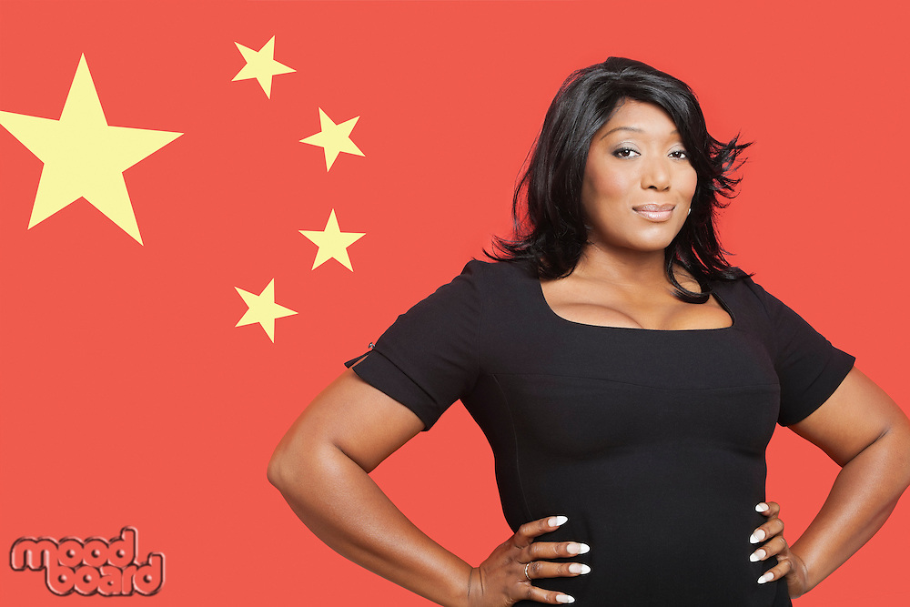 Portrait of casual mixed race woman against Chinese flag