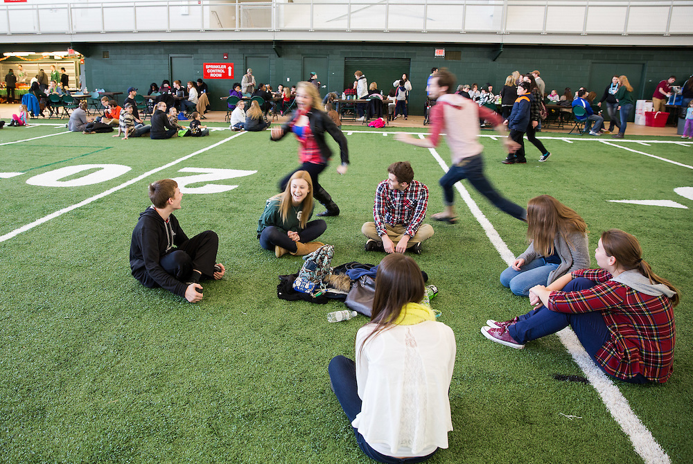 Brittney Wolfe gets chased while playing a game of duck duck goose with her siblings and friends during the Fiedlhouse Fest on Sibs Weekend.