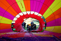 Looking into hot air balloon with being inflated for flight