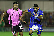 Andy Barcham of AFC Wimbledon and Darnell Furlong battle during the Sky Bet League 2 match between AFC Wimbledon and Northampton Town at the Cherry Red Records Stadium, Kingston, England on 29 September 2015. Photo by Stuart Butcher.