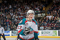 KELOWNA, CANADA - MARCH 23: Ryan Olsen #27 of the Kelowna Rockets skates to the bench to celebrate a goal against the Tri-City Americans on March 23, 2014 at Prospera Place in Kelowna, British Columbia, Canada.   (Photo by Marissa Baecker/Shoot the Breeze)  *** Local Caption *** Ryan Olsen;