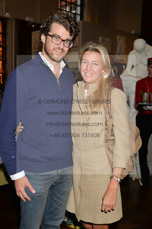 CAROLINE RUPERT and HICKMAN BACON at a party to celebrate the publication of Cartier's Panthere book at Maison Assouline, Picadilly, London on 7th September 2015