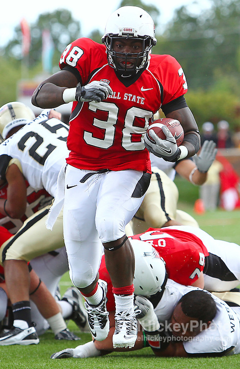 Sept. 24, 2011; Muncie, IN, USA; Ball State Cardinals running back Jahwan Edwards (38) runs the ball for a touchdown against the Army Black Knights at Scheumann Stadium. Mandatory credit: Michael Hickey-US PRESSWIRE