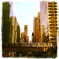 "The ""L"" Train passes by in Chicago. Photo taken on iPhone 4Gs and edited using Instagram App."