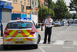 © licensed to London News Pictures. London, UK 27/07/2013. Police officers investigating a scene where a man was found stabbed in Poplar, east London.The victim, believed to be aged in his early 30s,  was announced dead on Friday, July 26 night. The Metropolitan Police said two men have been arrested on suspicion of murder following the investigation. Photo credit: Tolga Akmen/LNP