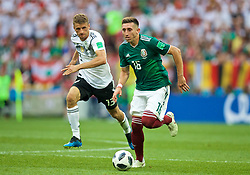 MOSCOW, RUSSIA - Sunday, June 17, 2018: Germany's Thomas Mueller (left) and Mexico's Hector Herrera (right) during the FIFA World Cup Russia 2018 Group F match between Germany and Mexico at the Luzhniki Stadium. (Pic by David Rawcliffe/Propaganda)