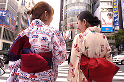 Young Japanese ladies in kimono in central Tokyo