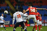 Bolton Wanderers striker, Emile Heskey (19) and Charlton Athletic defender Jorge Teixeira (50) challenge for the ball during the Sky Bet Championship match between Bolton Wanderers and Charlton Athletic at the Macron Stadium, Bolton, England on 19 April 2016. Photo by John Marfleet.