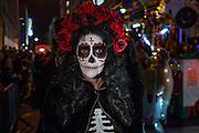 New York, NY - October 31, 2015. La Calavera Catarina with a coronet of red roses.