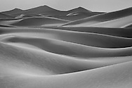 Soft light across the dunes adds a milky texture to the wind carved lines, Death Valley National Park