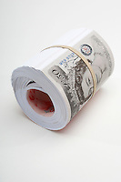 Roll of British paper currency