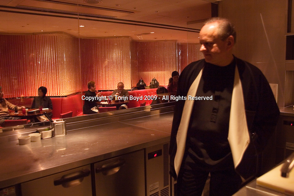 "This is world renowned chef Joel Robuchon in Tokyo, Japan. He is seen here on February 7, 2009 visiting his cafe located in Tokyo's Takashimaya Department Store called La Cafe de Joel Robuchon. Robuchon was in town to attend an international food exposition called ""2009 Tokyo Taste"". This three day event from February 9-11, 2009 showcases some of the world's most famous chefs including Robuchon and Ferran Adria (of El Bulli) who are both Honorary Advisors to this event. Other chefs participating in this event are Heston Blumenthal, Pierre Gagnaire, Jacques Puisais, Bruno Menard, Herve This, Ferran Adria, and Nobuyuki Matsuhisa to name a few. Robuchon has restaurants in Tokyo and Nagoya Japan including; L'Atelier de Joel Robuchon and Le Cafe Joel Robuchon. These establishments are connected with Four Seeds Corporation, a Japanese corporation that owns and operates several popular restaurant chains around Japan."