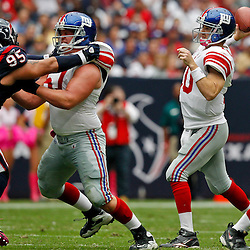 October 10, 2010; Houston, TX USA; New York Giants quarterback Eli Manning (10) throws a pass during the first half against the Houston Texans at Reliant Stadium. Mandatory Credit: Derick E. Hingle