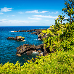 Hana Hawaii Sea Arch at Waianapanapa State Park. The Sea Arch is a popular attraction on the Road to Hana at Kuaiwa Point near Black Sand Beach. Copyright ⓒ 2019 Paul Velgos with All Rights Reserved.