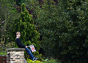 © Licensed to London News Pictures. 19/05/2012. WIndsor, UK A boy waits on a wall for the march to begin. Armed Forces muster and parade in Windsor today , 19th May 2012, in tribute to Her Majesty the Queen for the Diamond Jubilee. 2,500 troops paraded through the town before the Queen and Duke of Edinburgh to mark the Diamond Jubilee. Once the parade has passed the Queen and Duke traveled along the same route to an arena within Home Park, where the troops mustered. A tri-service flypast of 78 aircraft, including helicopters, Hawks, the Battle of Britain Memorial Flight, the Red Arrows and Tornados went overhead. Photo credit : Stephen Simpson/LNP