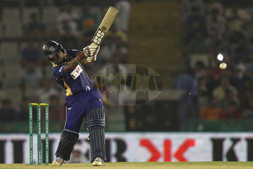 Dilshan Munaweera of the Barbados Tridents pulls a delivery straight to Manan Vohra of the Kings XI Punjab during match 5 of the Oppo Champions League Twenty20 between the Kings XI Punjab and the Barbados Tridents held at the Punjab Cricket Association Stadium, Mohali, India on the 20th September 2014<br /> <br /> Photo by:  Shaun Roy / Sportzpics/ CLT20<br /> <br /> <br /> Image use is subject to the terms and conditions as laid out by the BCCI/ CLT20.  The terms and conditions can be downloaded here:<br /> <br /> http://sportzpics.photoshelter.com/gallery/CLT20-Image-Terms-and-Conditions-2014/G0000IfNJn535VPU/C0000QhhKadWcjYs