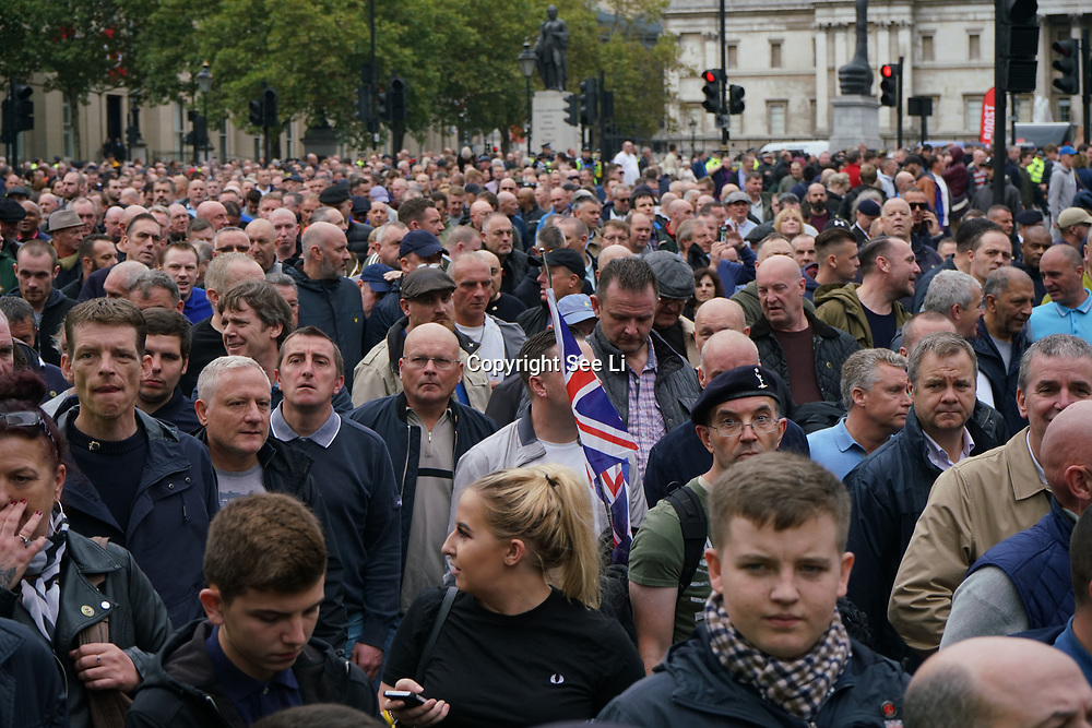 """London, England, UK. 7th October 2017. Thousands """"Football Lads Alliance"""" march in London AND Stand up against Racism protest against the """"Football Lads Alliance"""" March to Stand together: no to racism & Islamophobia and un-aspected Gurkha's veterans join the fascist """"Football Lads Alliance"""" at the roundabout in front of Trafalgar Square."""
