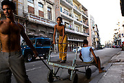 Cubans invent creative transportation methods out of necessity due to laws prohibiting buying or selling within the country.