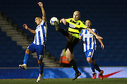 Huddersfield Town midfielder, on loan from Manchester City, Aaron Mooy (10) & Brighton & Hove Albion winger Anthony Knockaert compete for a high ball during the EFL Sky Bet Championship match between Brighton and Hove Albion and Huddersfield Town at the American Express Community Stadium, Brighton and Hove, England on 13 September 2016. Photo by Bennett Dean.