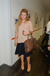 AMBER NUTTALL at the YOO 15 Anniversary Party hosted by John Hitchcox and Philippe Starck at Bankside, SE1 on 17th September 2014