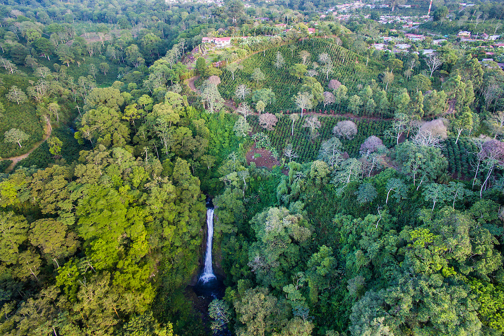 An aerial view of the town of Aquires and the Aquires waterfall in the Costa Rican jungle.