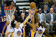 Golden State Warriors center Anderson Varejao (18) and forward Draymond Green (23) attempt to block a Los Angeles Lakers layup at Oracle Arena in Oakland, Calif., on November 23, 2016. (Stan Olszewski/Special to S.F. Examiner)