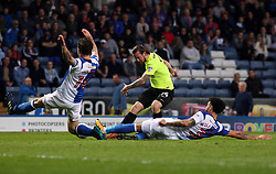 Jack Marriott of Peterborough United has a shot at goal blocked by Charlie Mulgrew and Derrick Williams of Blackburn Rovers - Mandatory by-line: Joe Dent/JMP - 19/04/2018 - FOOTBALL - Ewood Park - Blackburn, England - Blackburn Rovers v Peterborough United - Sky Bet League One