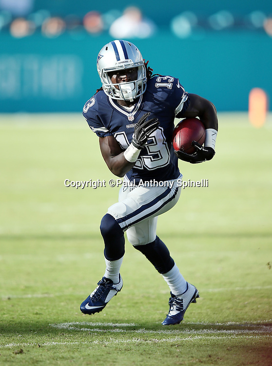 Dallas Cowboys wide receiver Lucky Whitehead (13) returns a punt during the 2015 week 11 regular season NFL football game against the Miami Dolphins on Sunday, Nov. 22, 2015 in Miami Gardens, Fla. The Cowboys won the game 24-14. (©Paul Anthony Spinelli)