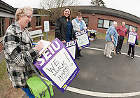 Supporters including Ann Marie Petell and Pat Boisvert line up outside Belknap County Nursing Home prior to their contract vote on Monday afternoon.   (Karen Bobotas/for the Laconia Daily Sun)