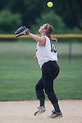 Brianna Fisher watches a ball fly over her head during a game against  Gibbstown Thursday July 7, 2011 in Clayton NJ.