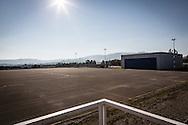 Pisticci Scalo, Basilicata, Italia 27/01/2016 <br /> L'hangar e il parcheggio aeromobili dell'aviosuperficie &quot;E.Mattei&quot;. <br /> Indicata anche come aviosuperficie di Basilicata, si trova a Pisticci Scalo, in provincia di Matera.<br /> <br /> La struttura venne realizzata negli anni '60, durante l'industrializzazione della val Basento, su iniziativa di Enrico Mattei, per una sua personale maggiore rapidit&agrave; di spostamento tra i siti ENI.<br /> <br /> Inutilizzata per molto tempo. Il 22 maggio 2014 &egrave; stata affidata dal CSI (consorzio per lo sviluppo industriale) di Matera la gestione della stessa aviosuperficie alla societ&agrave; aerotaxi Winfly, che ha sede all'Aeroporto di Pontecagnano, vicino Salerno.<br /> <br /> Al momento, la struttura consente l'atterraggio a velivoli con una capienza massima di nove posti.<br /> <br /> Pisticci Scalo, Basilicata, Italy, 27/01/2016<br /> The hangar and airplane parking area of the airstrip &quot;E. Mattei&quot;.<br /> Also named as &quot;Airfield of Basilicata&quot;, it is located in Pisticci Scalo, near Matera.<br /> <br /> The structure, a simple airstrip, was built in the 60s, during the industrialization of the Basento valley, on the initiative of Enrico Mattei, for a faster personal transfer between ENI company sites.<br /> <br /> Unused for a long time. On the 22nd May 2014 the CSI (Consortium for Industrial Development) of Matera entrusted the management of the airfield to the air taxi Winfly company, based in the Airport of Pontecagnano near Salerno.<br /> <br /> At the moment, the structure allows the landing to airplanes with a maximum capacity of nine seats.