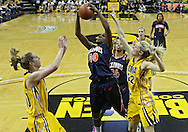 February 24 2011: Illinois Fighting Illini forward Karisma Penn (00) pulls in a rebound between Iowa Hawkeyes forward Kelly Krei (20) and Iowa Hawkeyes forward Kelsey Cermak (22) during the first half of an NCAA women's college basketball game at Carver-Hawkeye Arena in Iowa City, Iowa on February 24, 2011. Iowa defeated Illinois 83-64.
