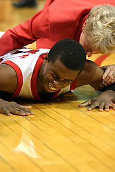 Vince Greene is assisted by ISU's Athletic Trainer Kathy Schniedwind after falling to the floor.
